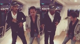 Marc Anthony le da clases de salsa a Will Smith en un yate (VIDEO)